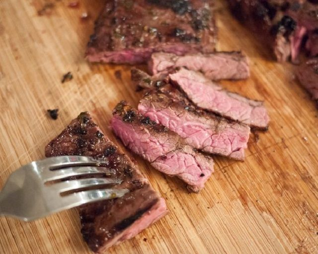 Steak on the grill marinated in citrus fruits