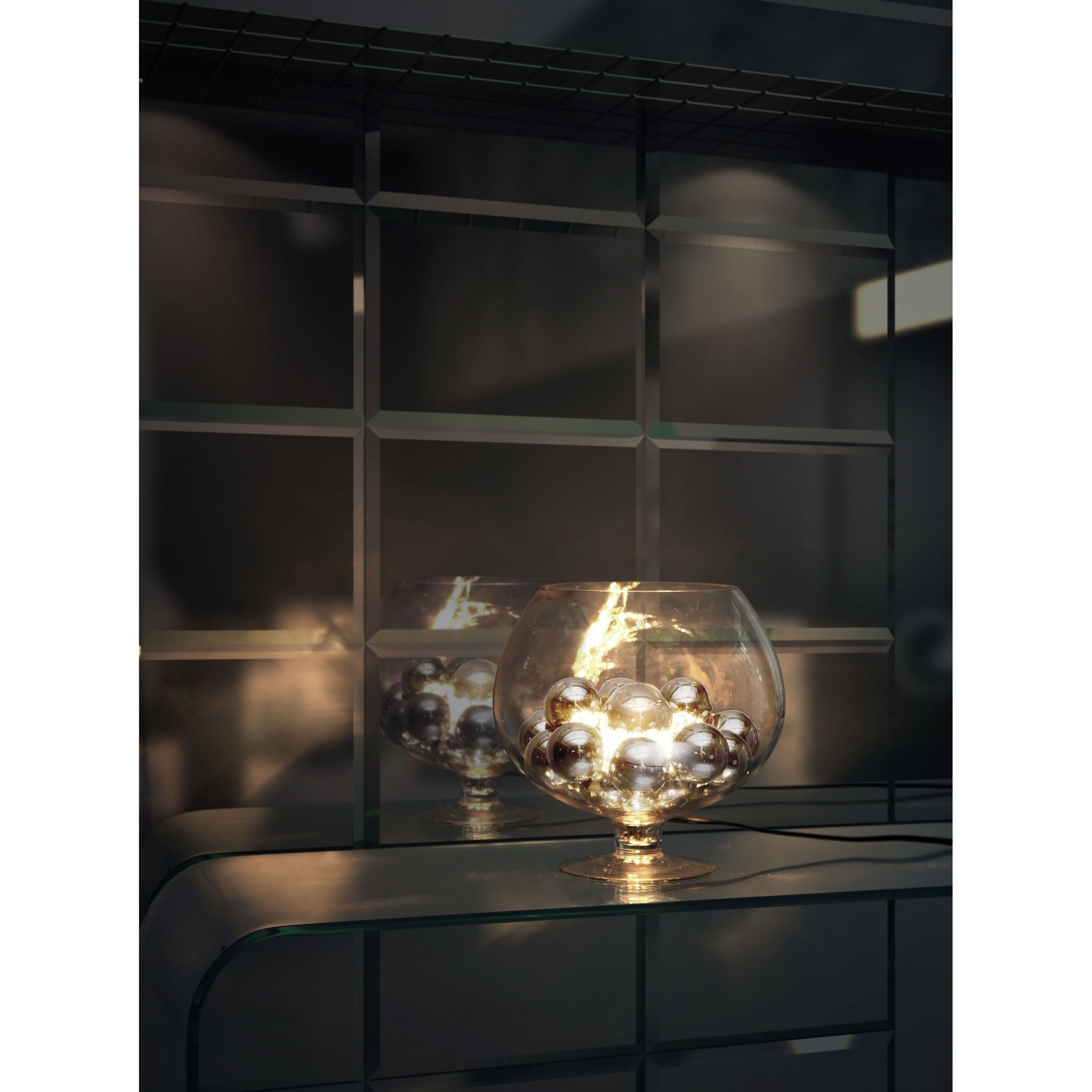 The elegance of chrome orbs enhances the look of this unique table lamp. The Terran lamp shines and reflects off of the chrome spheres creating a beautiful glow for any decor setting.