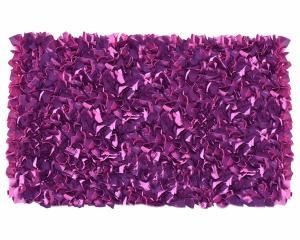 The Plum NEON Shaggy Raggy rug is an adorable accent to complement any living room, public spaces or event decoration. This rug is made of super comfy cotton jersey; each strips is hand tied to achieve its unique look. Available in multiple sizes and colors combinations. For more information visit www.bauti.nl