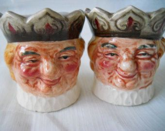 215 - This set of salt and pepper shakers was purchased from a collectors estate in Florida. They are used and in good condition with some