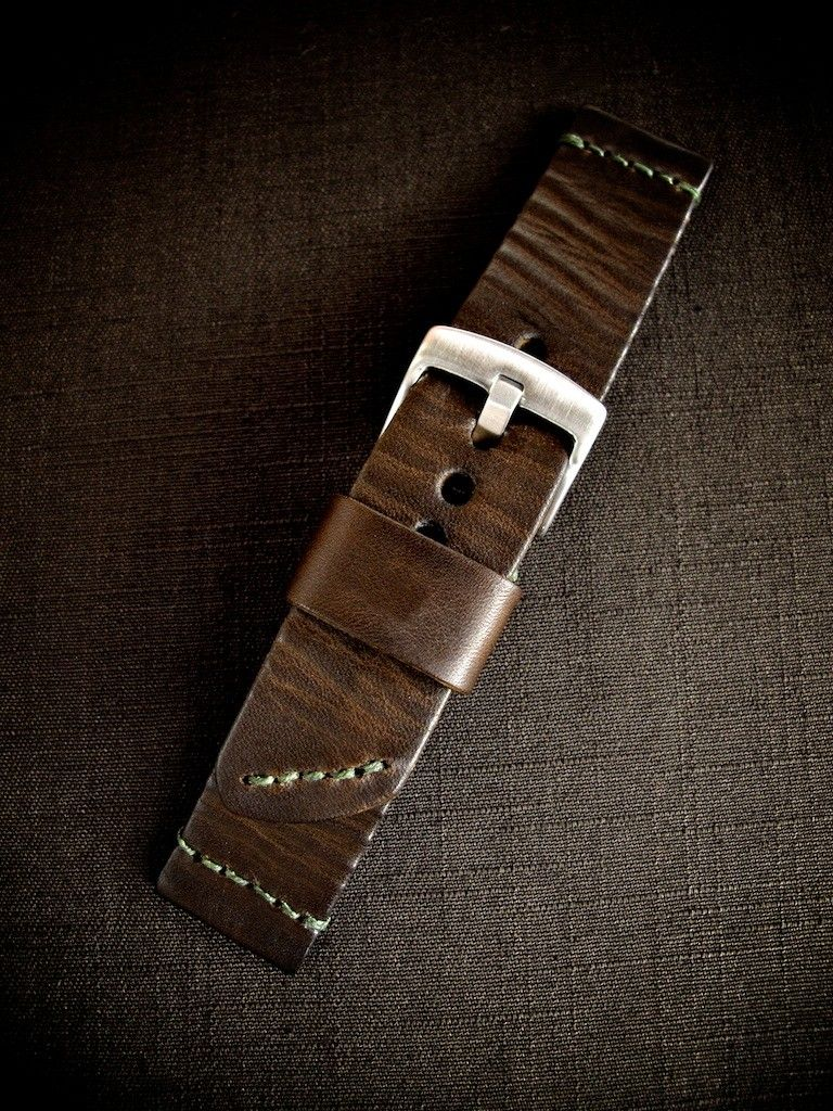 """How gorgeous is this one?! """"Mirza"""" is a beautiful, vintage inspired brown handmade leather ammo style watch strap. This strap is incredible. Hand dyed a rich warm brown and hand manipulated to give it its special charm and character. This watch strap is a perfect 3.8mm thick, features green waxed linen thread, a pointed tail, floating keeper and ammo style stitching. One of our new favorites. You'll love this beauty. Timeless and rugged and classy all at once.    www.basandlokes.com"""