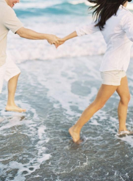 Holding hands on the beach.