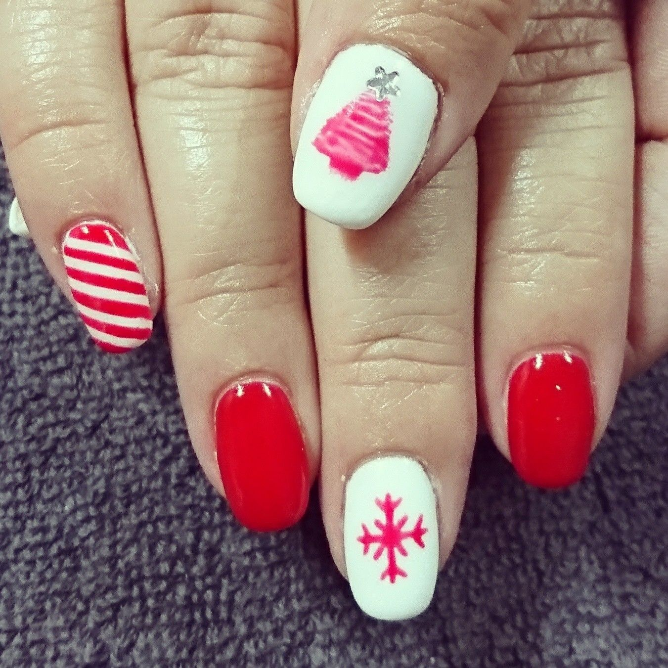 Red and white Christmas nails with stripes, snowflake and Christmas tree