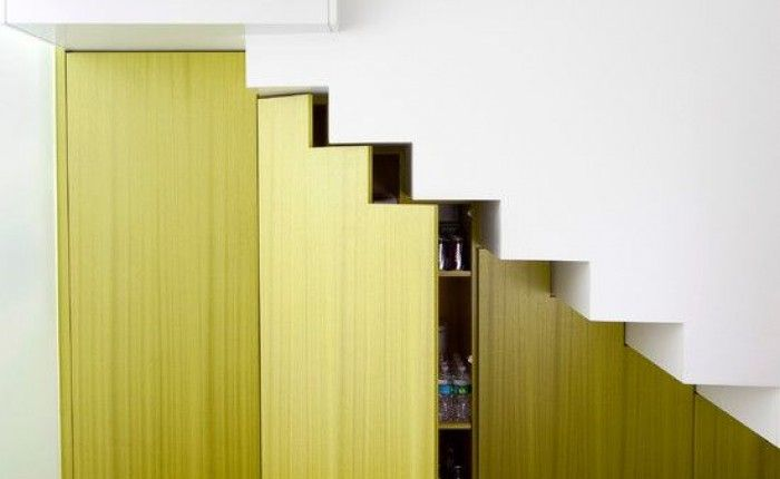 Remodelista: under-the-stairs wine cellar - love that  color too