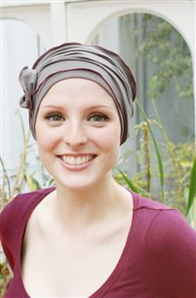 9166846b99560 Chic turban for womens hair loss. This pretty hat for hair loss is a little  different from the usual chemo headwear.