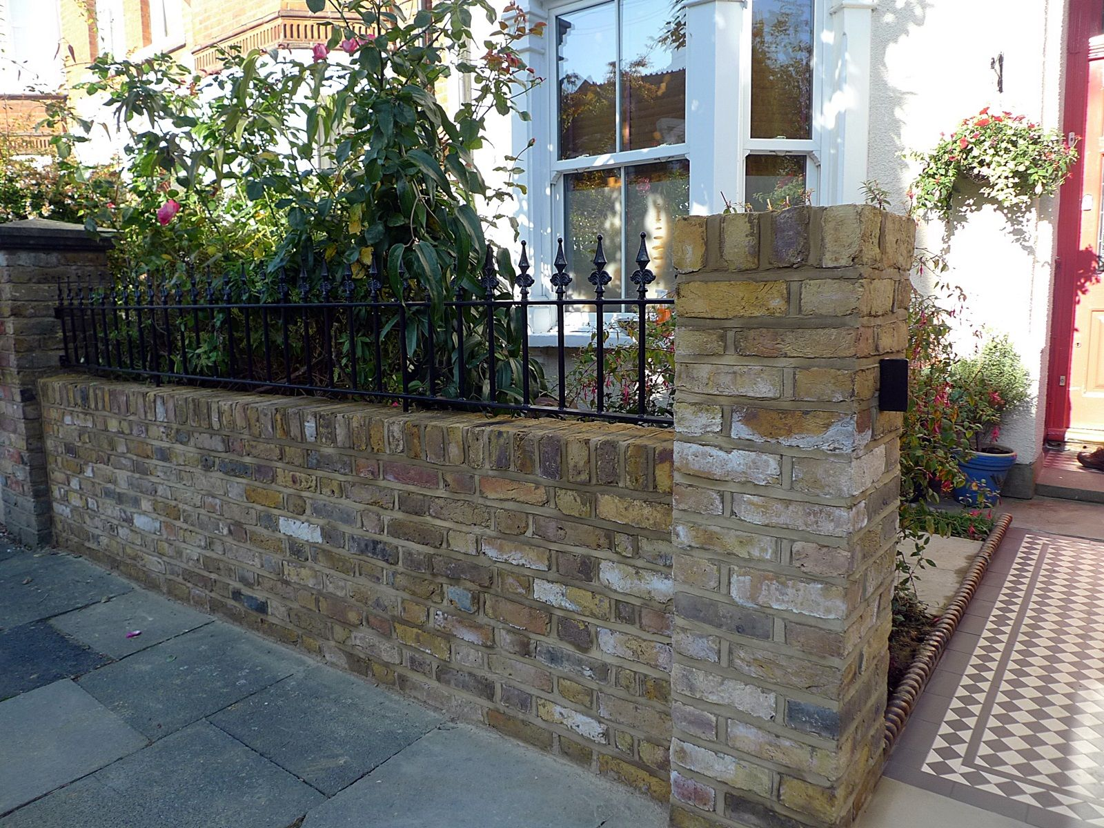 london front garden yellow stock brick wall with struck pointing