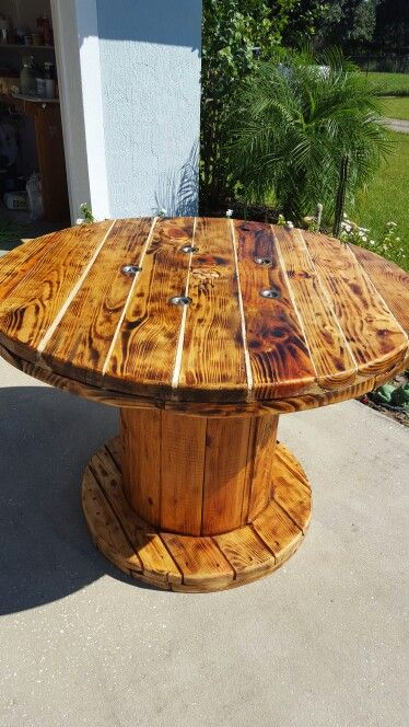 Dining room table made from large wooden spool my for Wooden reel furniture