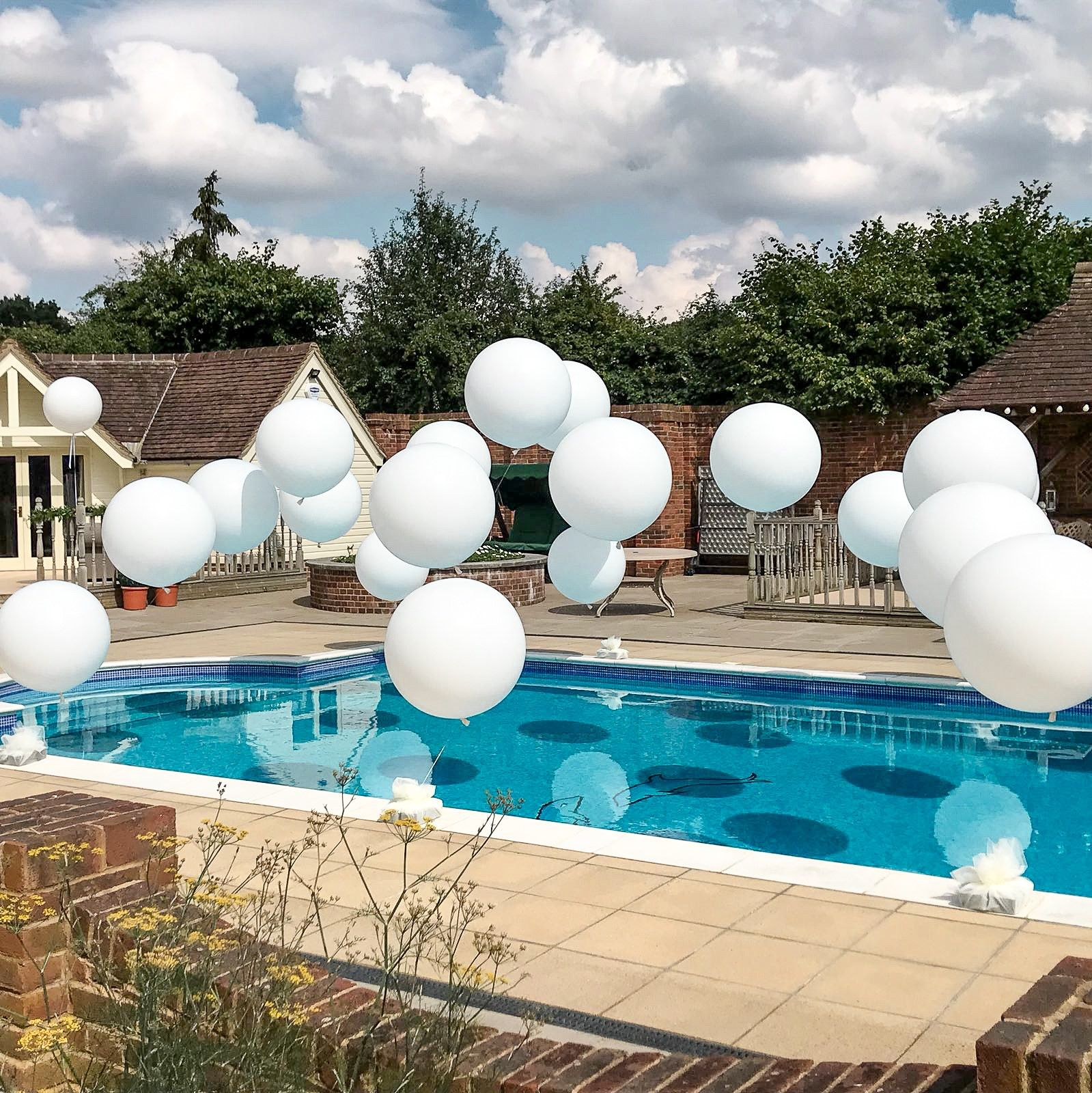 96 Fun Facts About Your Favorite Bridal Designers: Pool Balloons, Pool Party