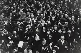 Celtic football supporters cheering as their team scored a goal in 1971. Harry Benson