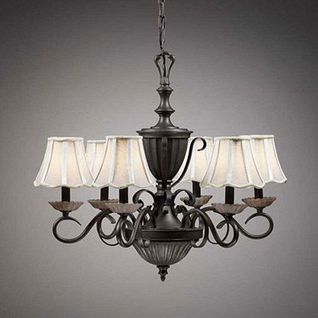 Add a colonial touch to your home with this colonial six-light chandelier. Constructed of bronze-finished steel, this chandelier is built for six 60-watt bulbs, giving you plenty of light for dining or other activities. Ivory fabric shades are included.