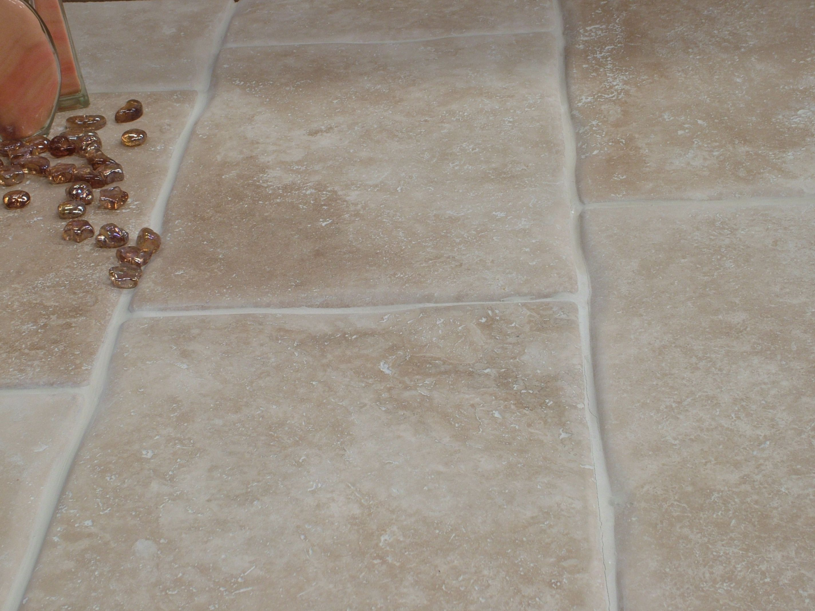 Sedimentary travertine floor tile characterised by a medium cream sedimentary travertine floor tile characterised by a medium cream to walnut colour on a smooth honed dailygadgetfo Gallery