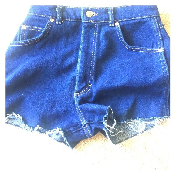 Lee high waist cut off shorts, vintage style True blue denim without much stretch, these are high waist and would look great with a crop top or vintage style. Never worn, nwot. Run slightly small. Shorts Jean Shorts