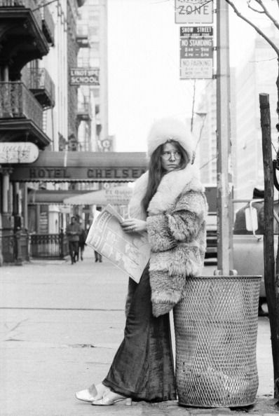 Blues singer Janis Joplin poses for a portrait on March 3 1969 outside of the entrance to the Chelsea Hotel in New York City New York