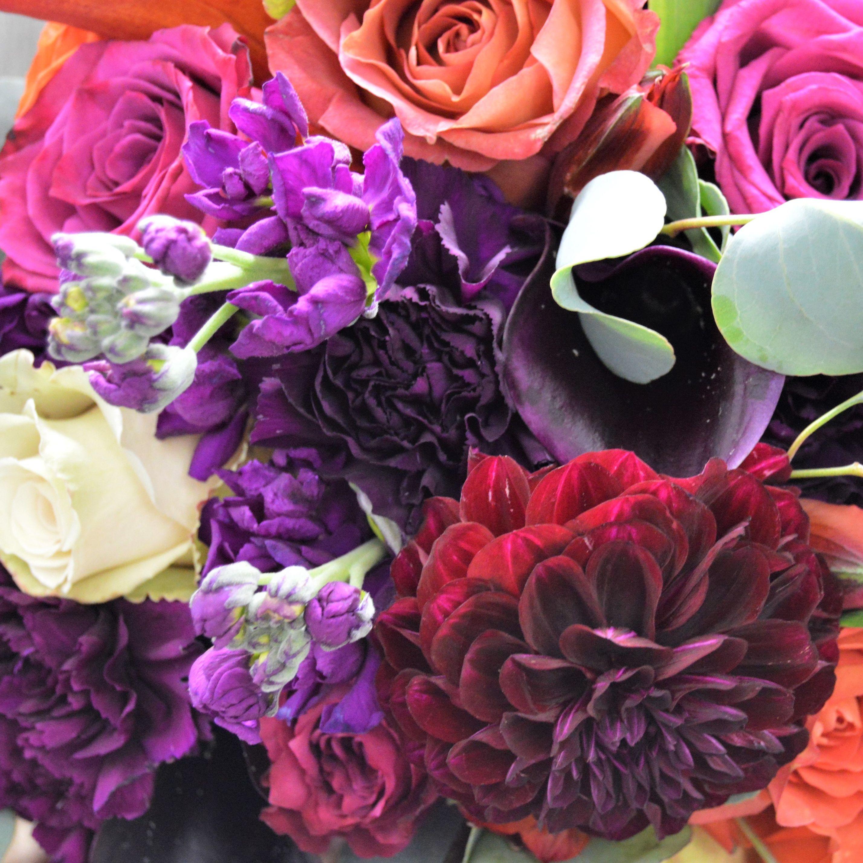 Dark purple calla lilies are our favorite purple calla