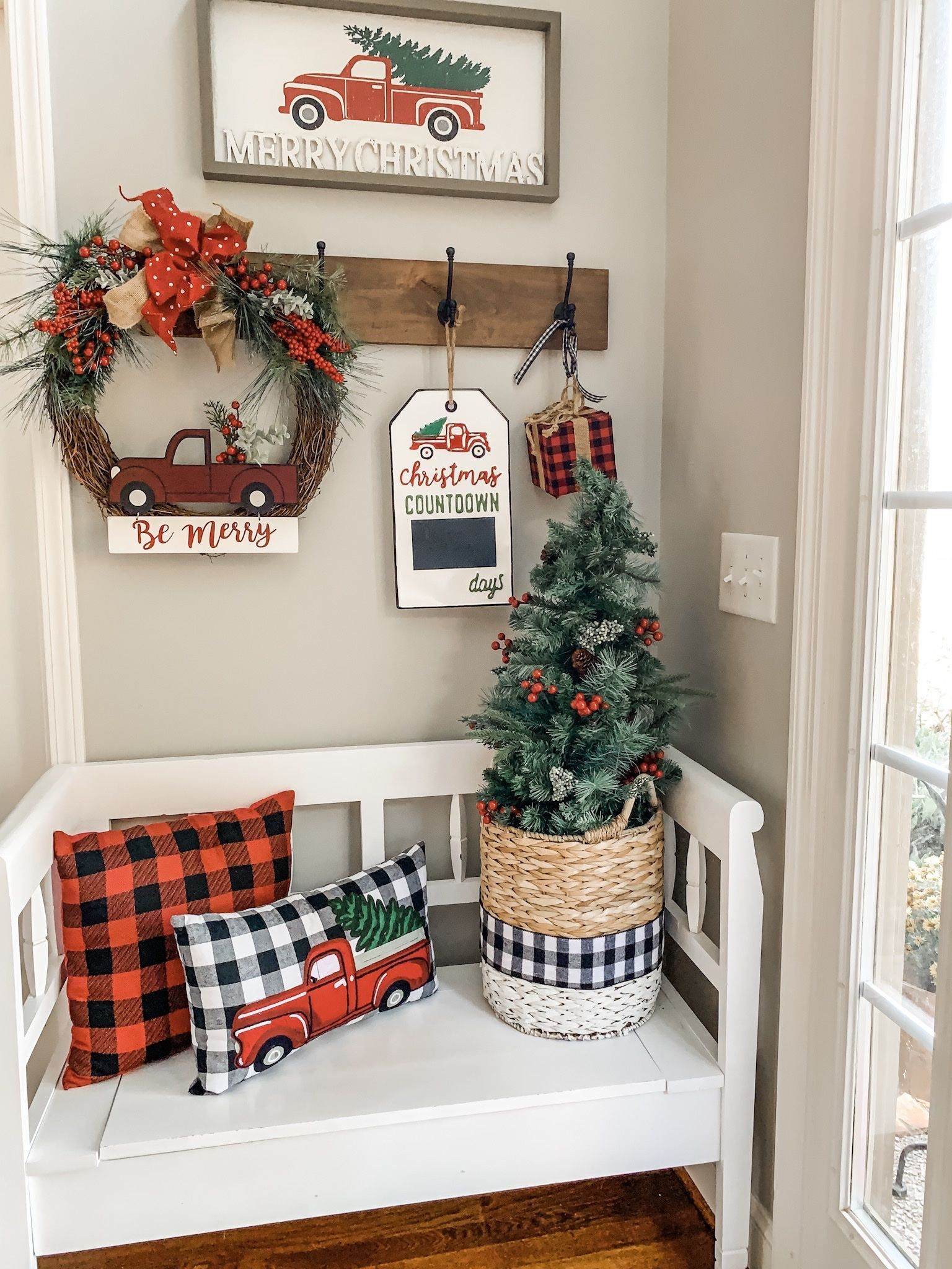 Christmas truck decor in my entry way! | Wilshire Collections #porchdecor #christmasdecor #christmasoutdoordecor #southernporches