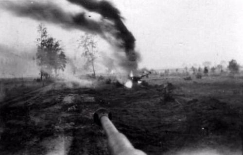 """Burning T-34-85. The picture was taken by the commander of the """"Tiger""""."""