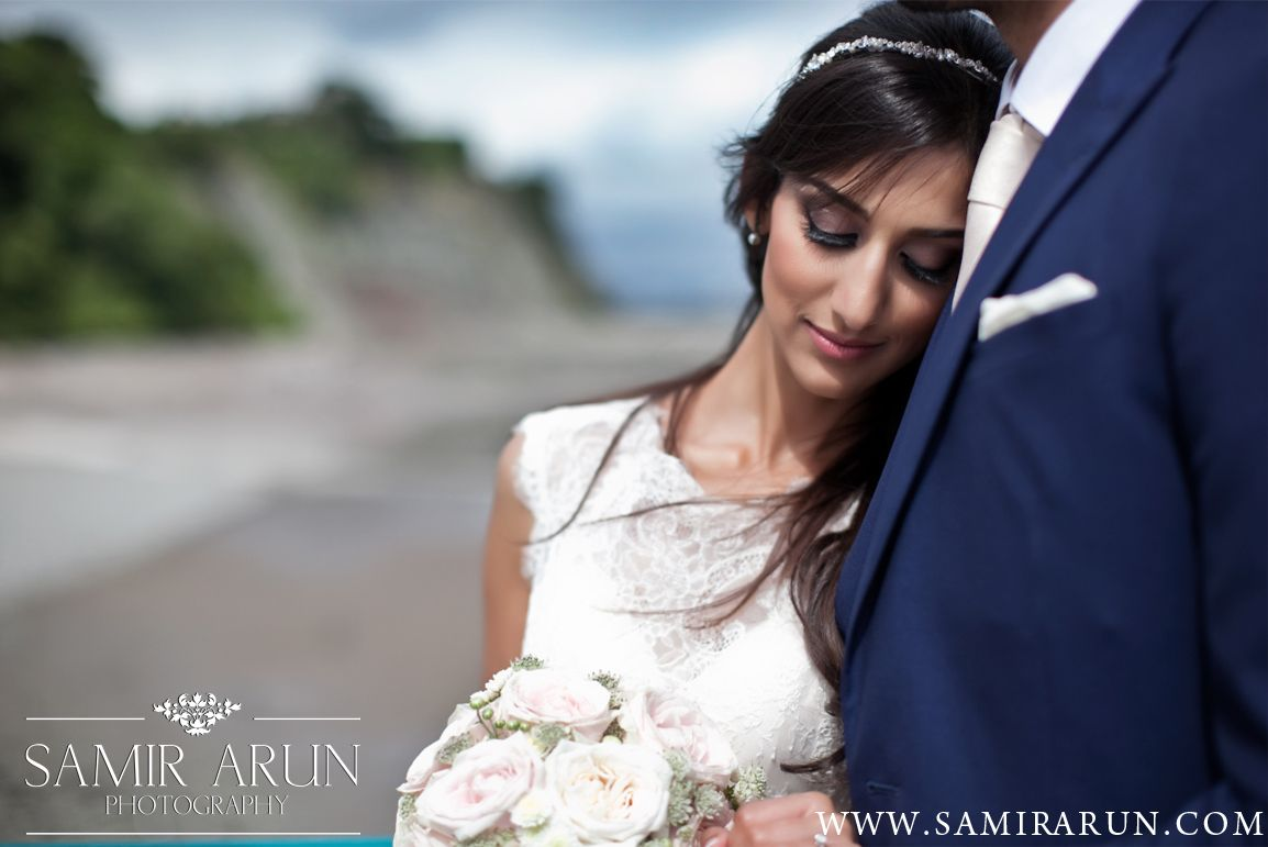Couple photo from civil wedding in cardiff penarth pier bride