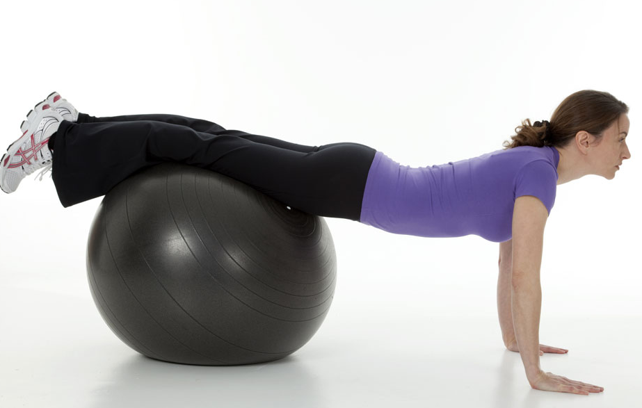 How To: Get Rid Of The Mommy Belly. This variation of the push-up uses a stability ball to engage your core. It is useful for moms who've delivered through C-section.