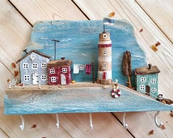 Photo of Keychain made of wood with small wooden houses, nautical decor, wood