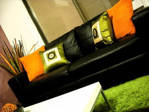 Green Cushions Living Room Modern Gallery Wall Orange Lime Shaggy Rug Black Couch Sofa Interior Design Decoration