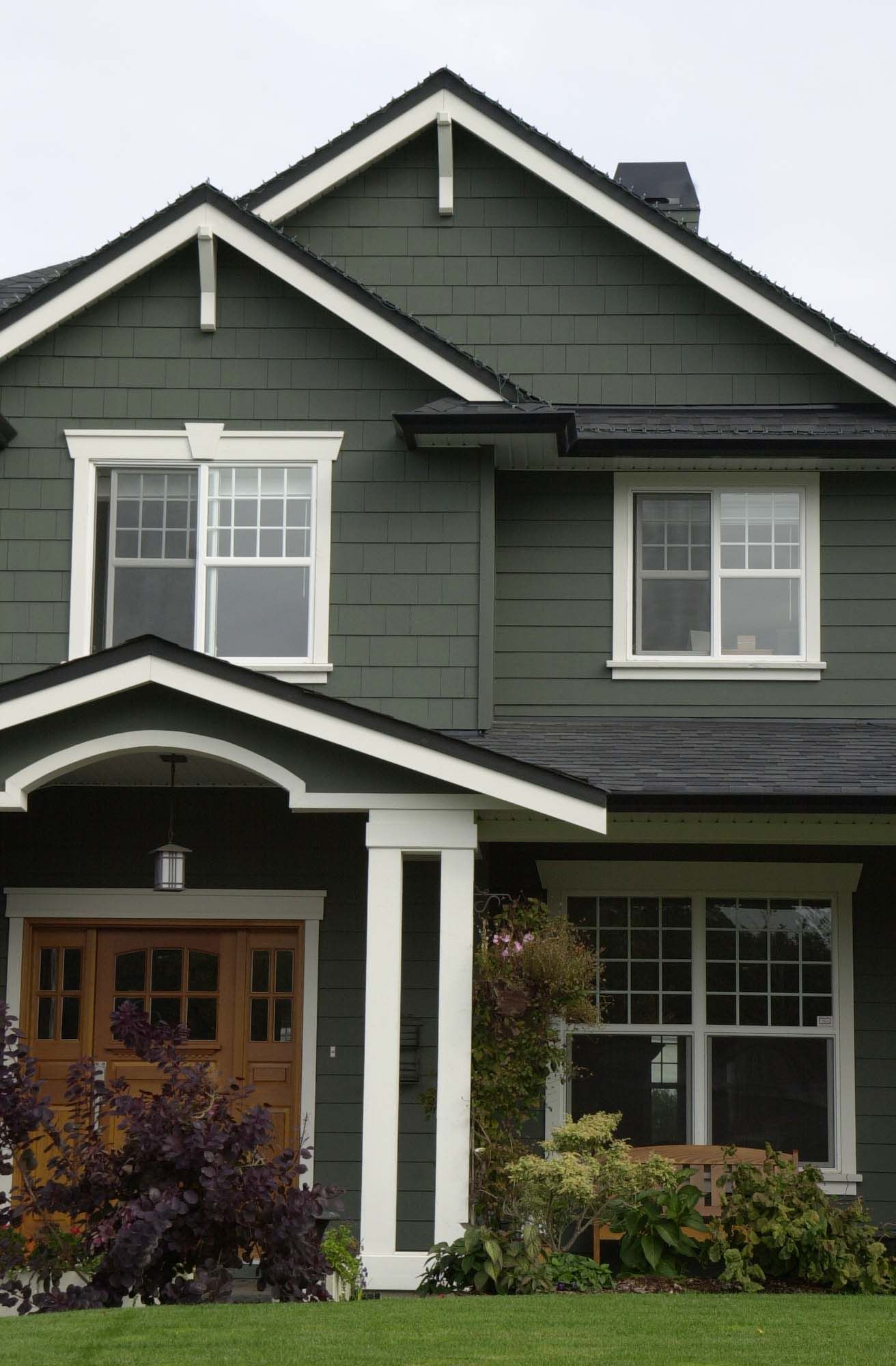 Cedar Pine A Strong Deep Green With Crisp White And Black Accents Creates A Highly Drama Green Exterior House Colors House Paint Exterior Green House Color