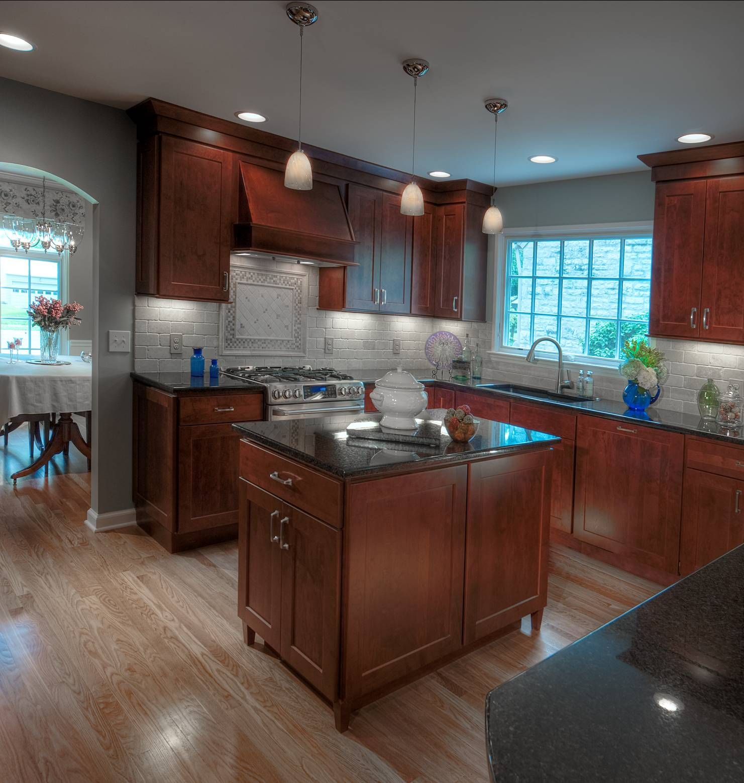 Maple Kitchen Countertops: Dark Maple Cabinets, Black Granite Tops And Travertine