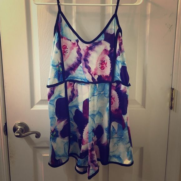 Mulit colored romper Blues and purple romper. Never used. Comfortable material! Other