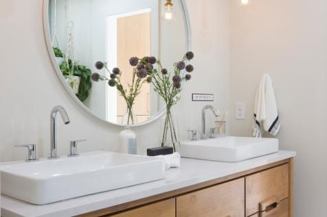 neutral midcentury modern master bathroom with white his