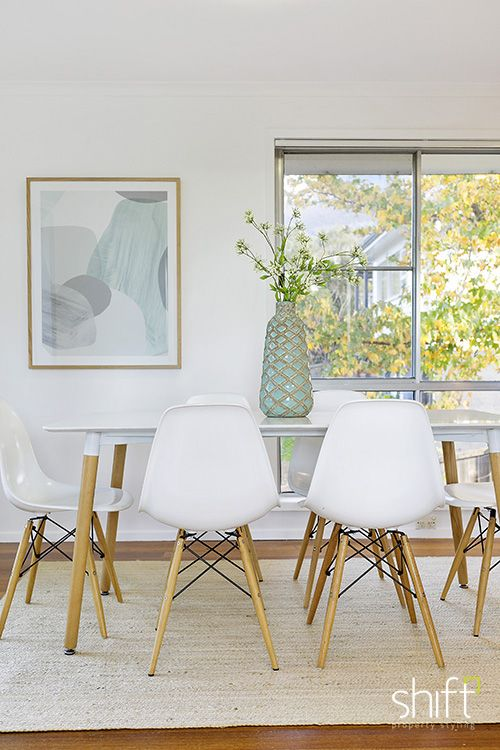 bush setting layers white dining table eames chairs pastel art