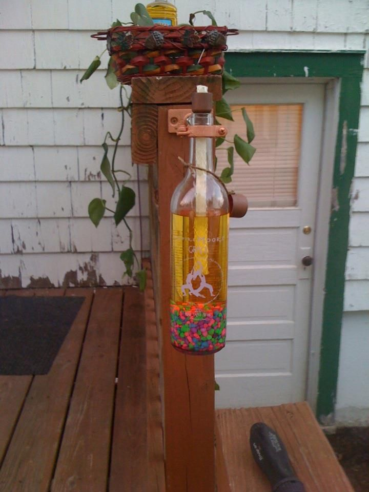 Wine Bottle Tiki Torch...we made these for everyone for Christmas and will be presents for the 4 weddings I have this summer! I ♥ Them!
