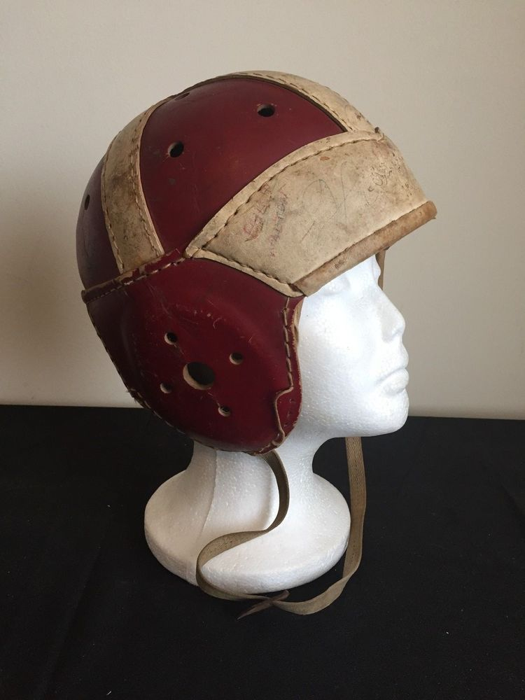 Antique leather football helmet c 1930s on the fromt it