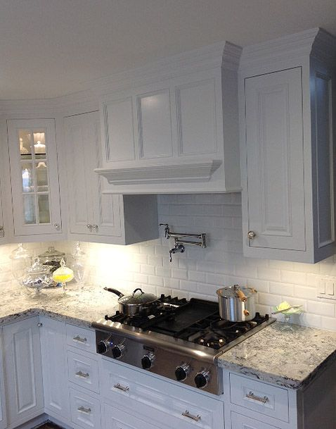 Clean Sleek Elegant White Kitchen Cabinets With Marble Counter Tops In Rossmoor Ca