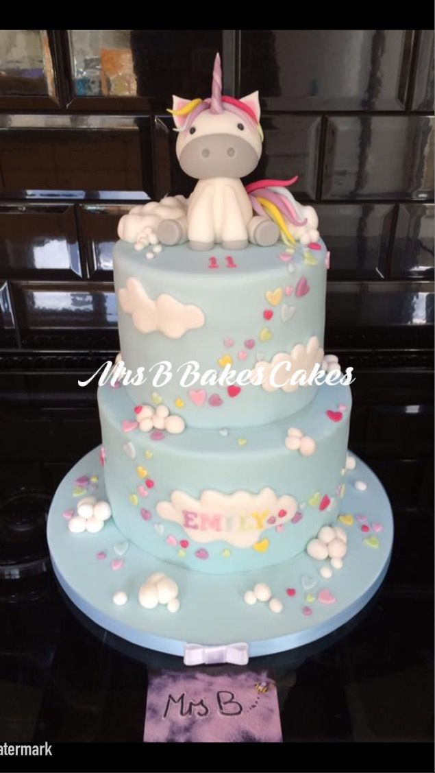 A charming whimsical unicorn themed birthday cake and smash cake