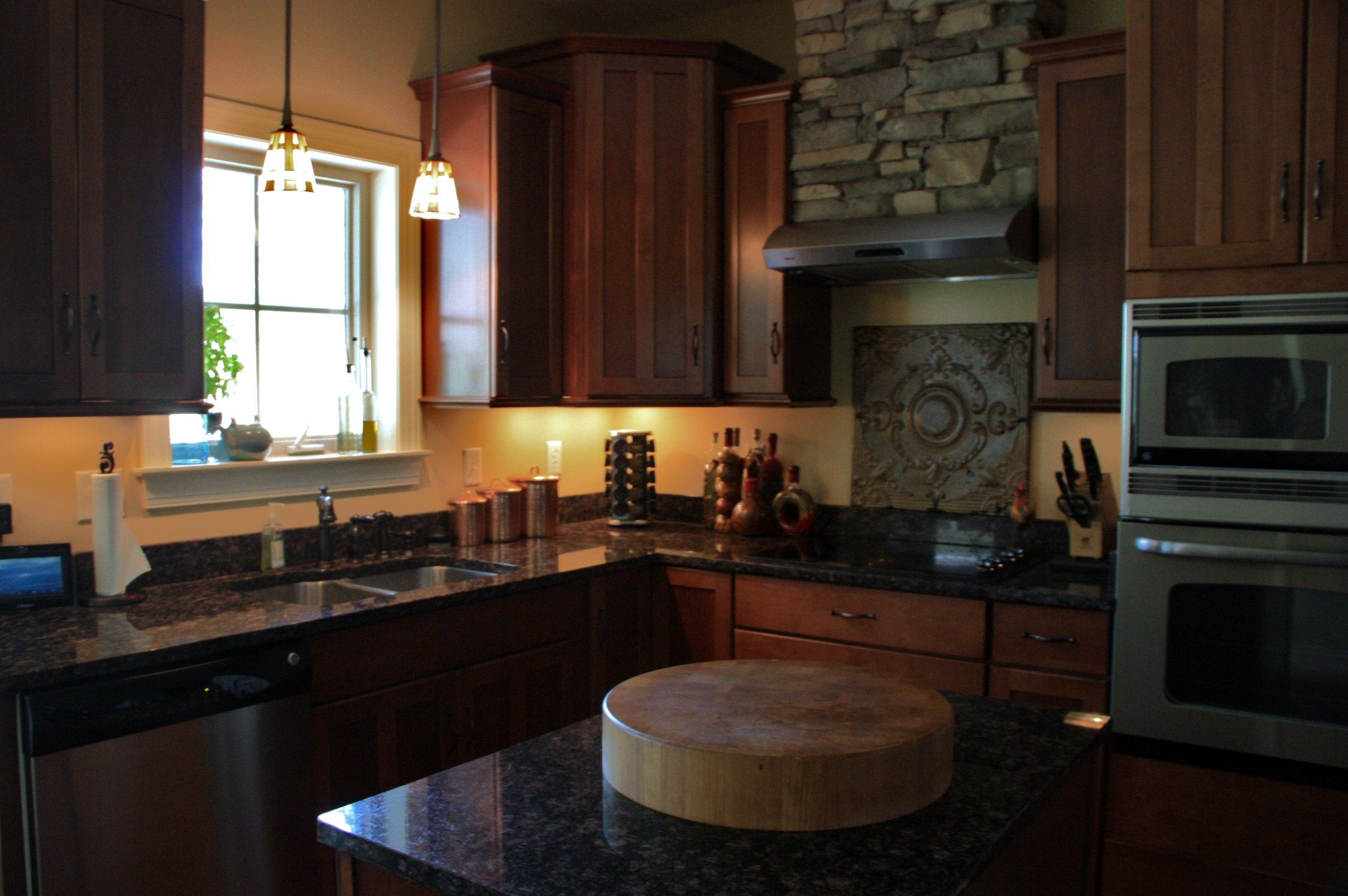 i like how they used the stacked stone over the range hood rustic kitchen kitchen vent on outdoor kitchen vent hood ideas id=42864