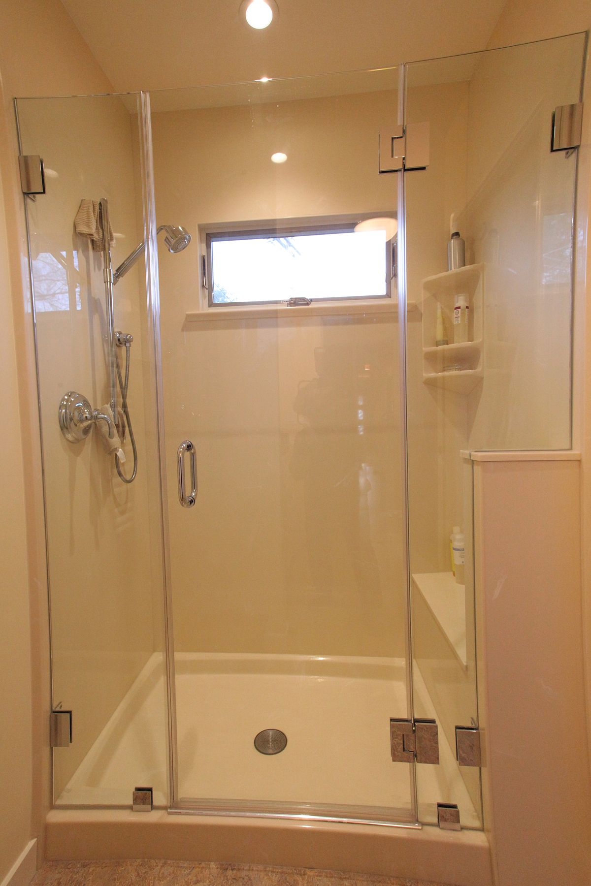 Cultured Marble Shower Surround With Frameless Glass Shower Door
