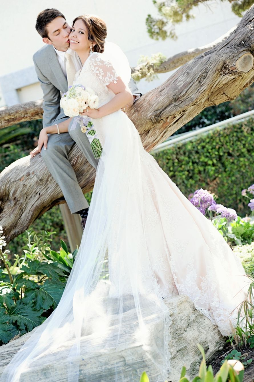 Gorgeous modest lace wedding gown and a cathedral length veil and
