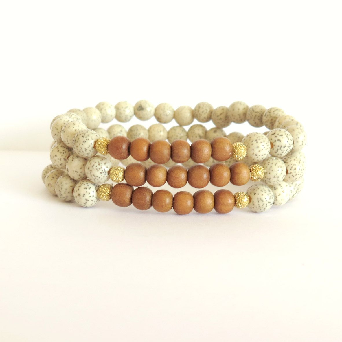 White Lotus Seed Bracelet with Fragrant Indian Sandalwood / Boho Chic Bracelet / Meditation / Yoga Jewelry / Minimalist Eco Friendly Chic by theblackstarboutique on Etsy https://www.etsy.com/listing/251218269/white-lotus-seed-bracelet-with-fragrant
