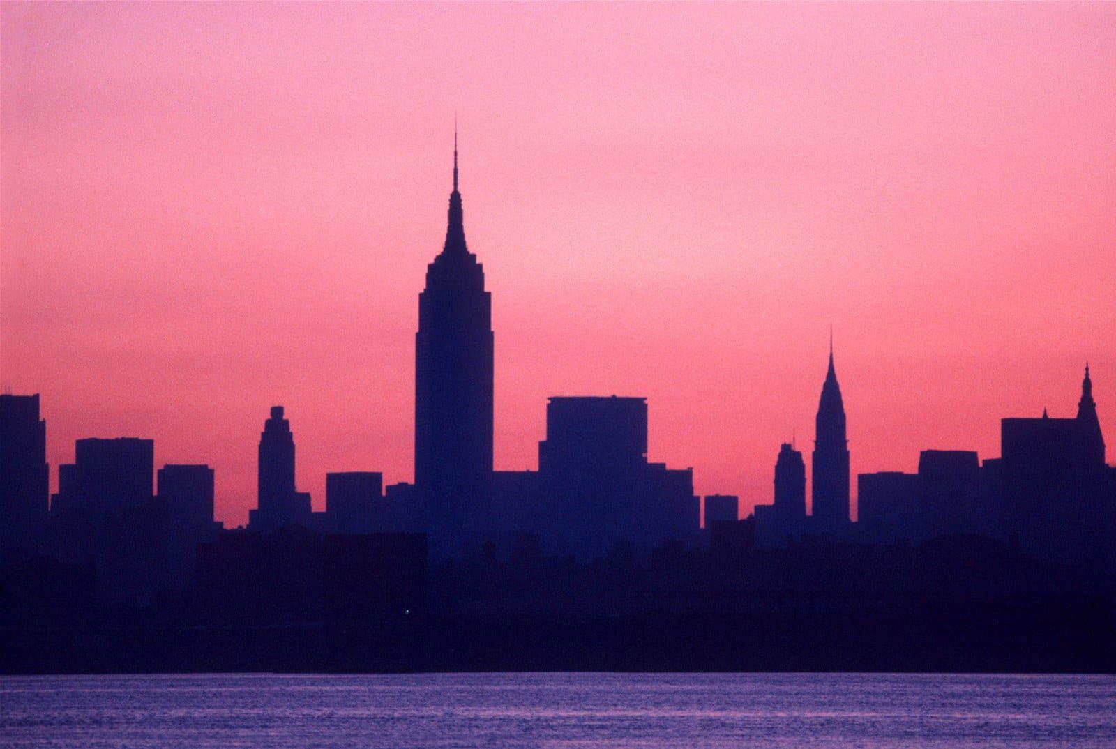 At dawn on July 14, the Manhattan skyline shows no lights