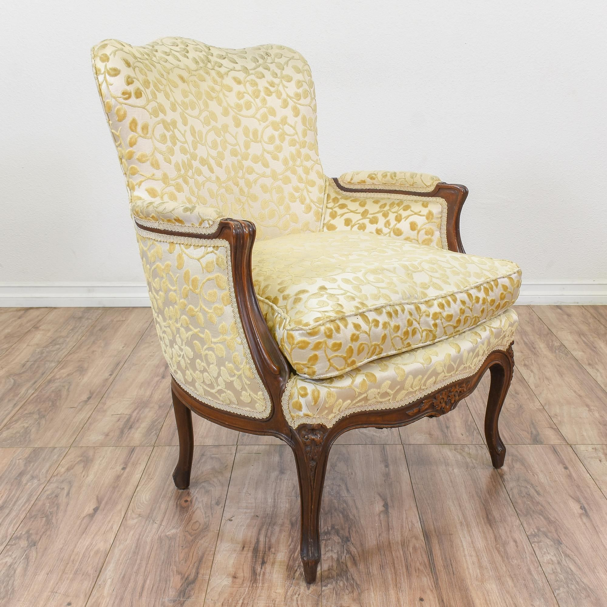 This bergere chair is upholstered in a durable off white cream