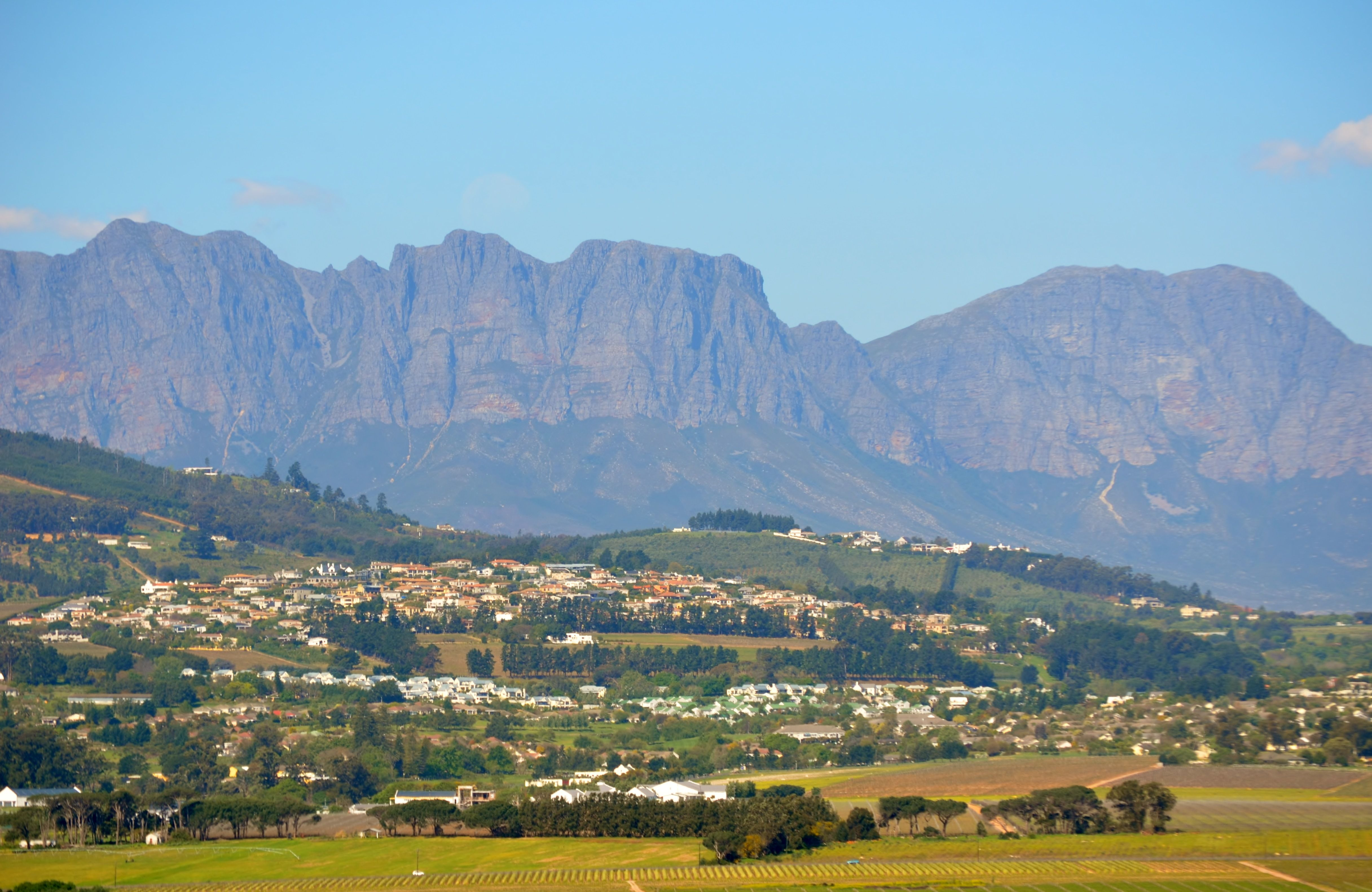 Somerset West suburbs such as Helena Heights and Monte Sereno as seen from the western side of the town. Hottentots-Holland mountain range as the backdrop. #MonteSoreno #HelenaHeights #SomersetWest #CapeTown