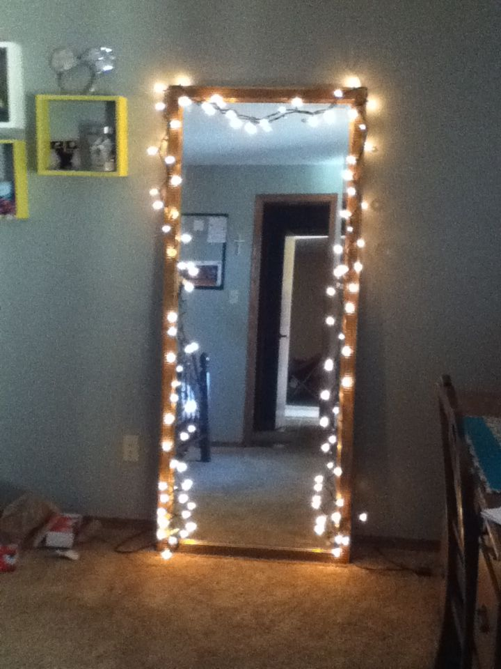 Hang christmas lights up on your mirror in your room for Creative ways to hang christmas lights indoors
