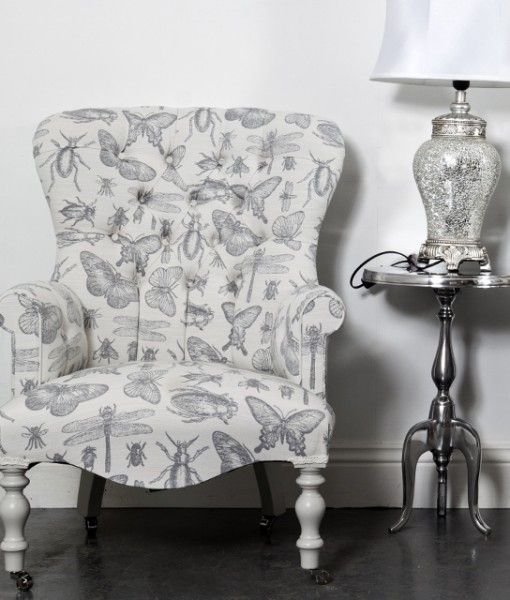 A Quirky Bedroom Chair With Silver Bug Design
