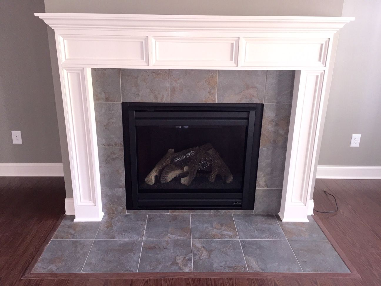 Custom Fireplace Features A Flush Hearth And A Stone