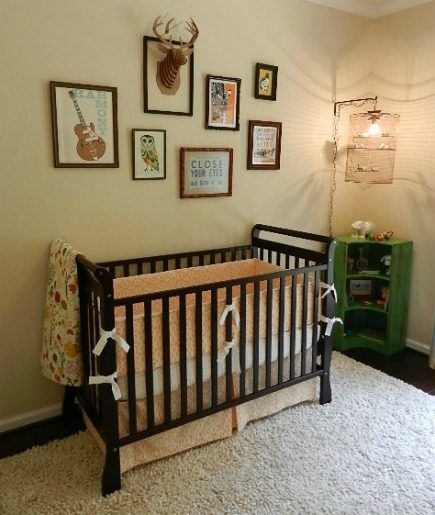 Eclectic Gender Neutral Nursery With Dark Stain Wood Sleigh Style Adjustable Crib And Custom Bedding Deer AntlersDeer HeadsNeutral NurseriesBaby