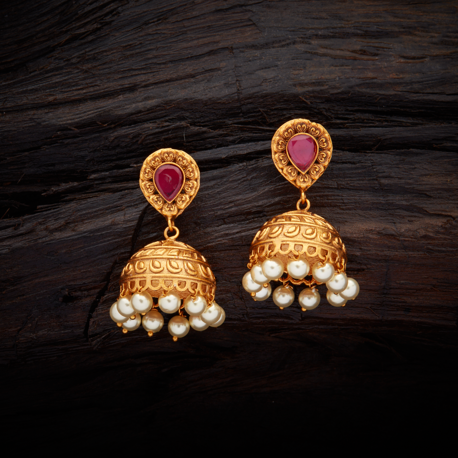 aae6d0713 Vintage Design Antique Jhumka earrings studded with Ruby synthetic stones,  with gold Polish.
