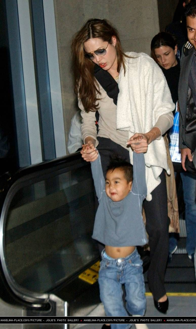 2012/04/15 - Angelina and Kids hit LAX Airport - 280304 Jolie at LAX 03 - Angelina Jolie Photo