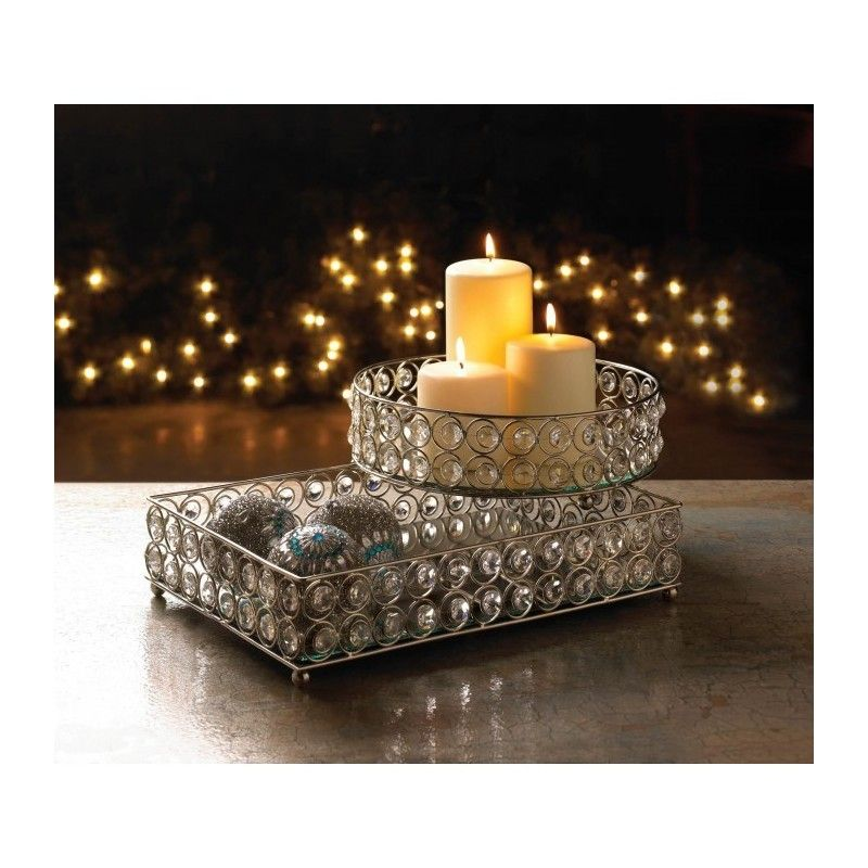 SHIMMER RECTANGULAR JEWELED TRAY Decorate your tabletop, vanity or dresser with elegance and shimmering style! This gorgeously glamorous tray features round faceted clear gems that sparkle and shine in the light. It's a perfect display tray for your perfumes, cosmetics, and more!  Materials: GLASS IRON