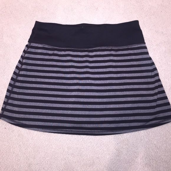 Ideology tennis skirt striped w/shorts size small Tennis skirt by ideology black and gray striped with built-in shorts size small. NWOT Ideology Skirts