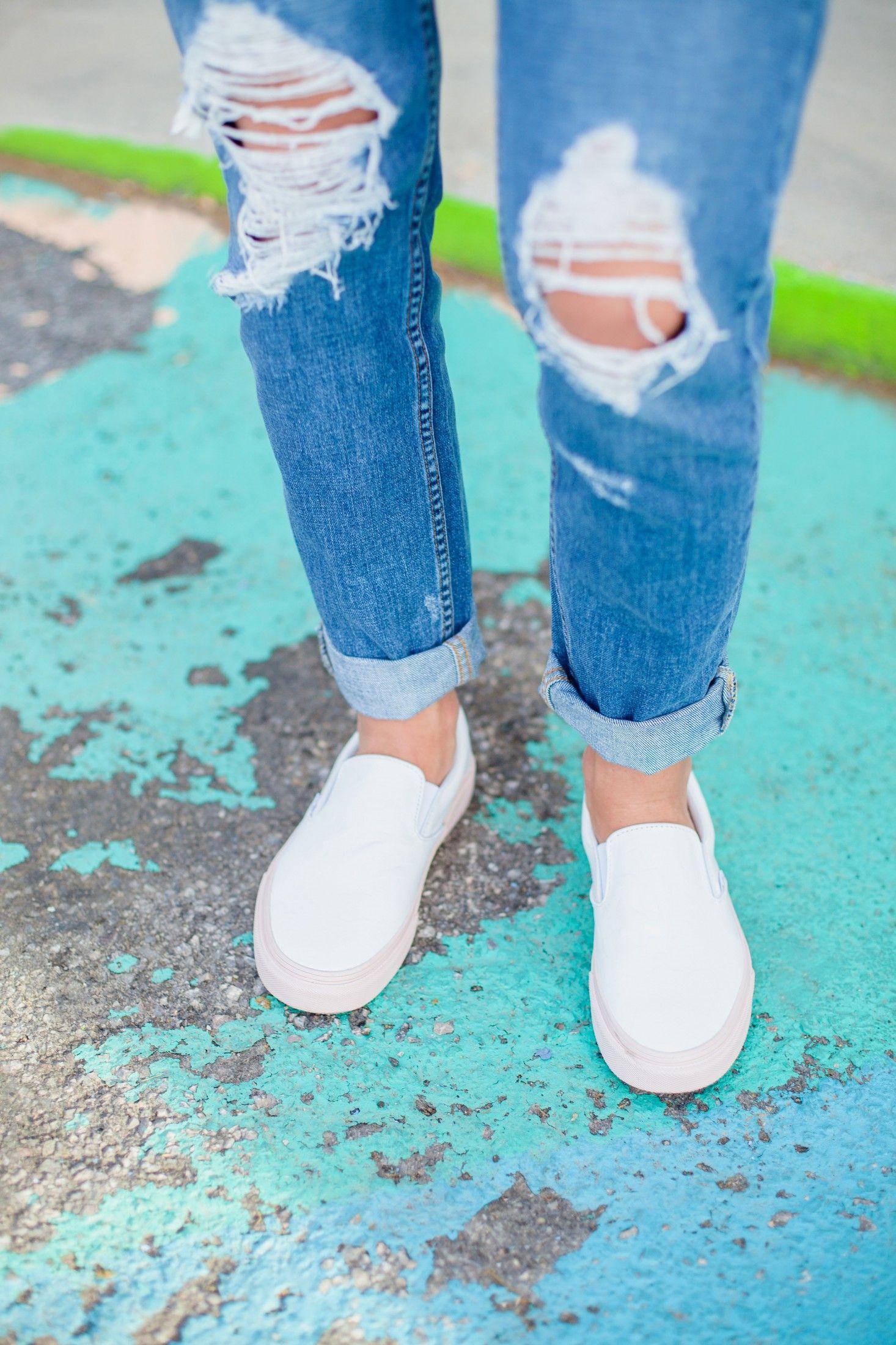 vans slip on white on feet