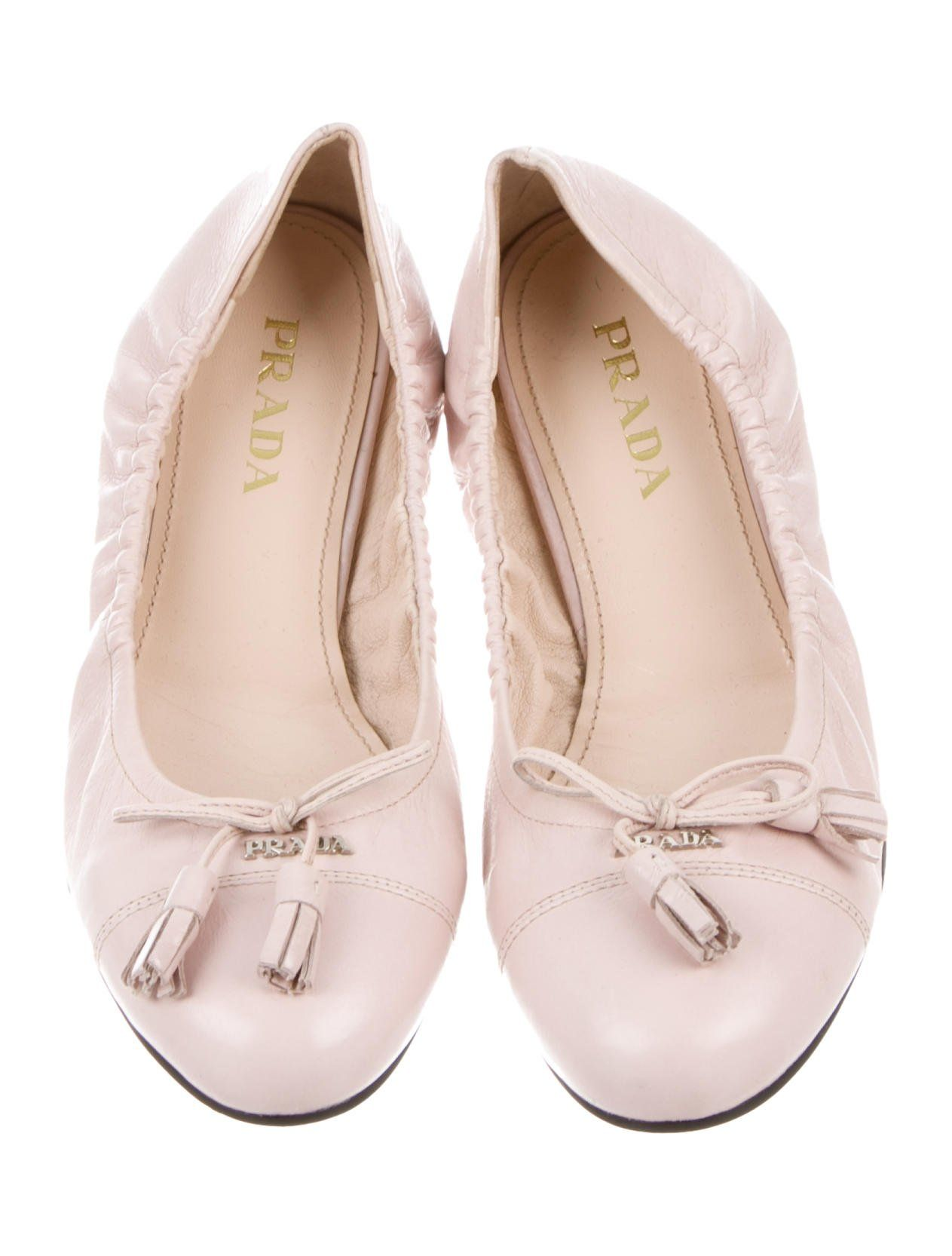 18ec4767d9 Pink leather Prada round-toe ballet flats with bow accent at vamps  featuring logo embellishment, contrast stitching and rubber heels.prada #flats#ballet# ...
